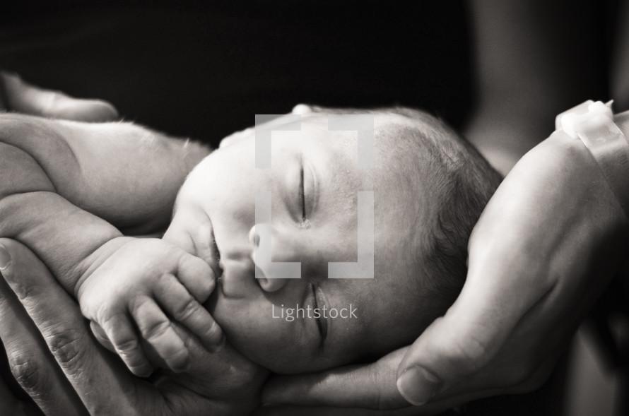 Parents holding infant