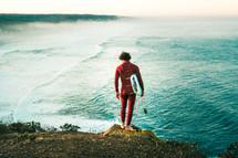 surfer standing on a beach