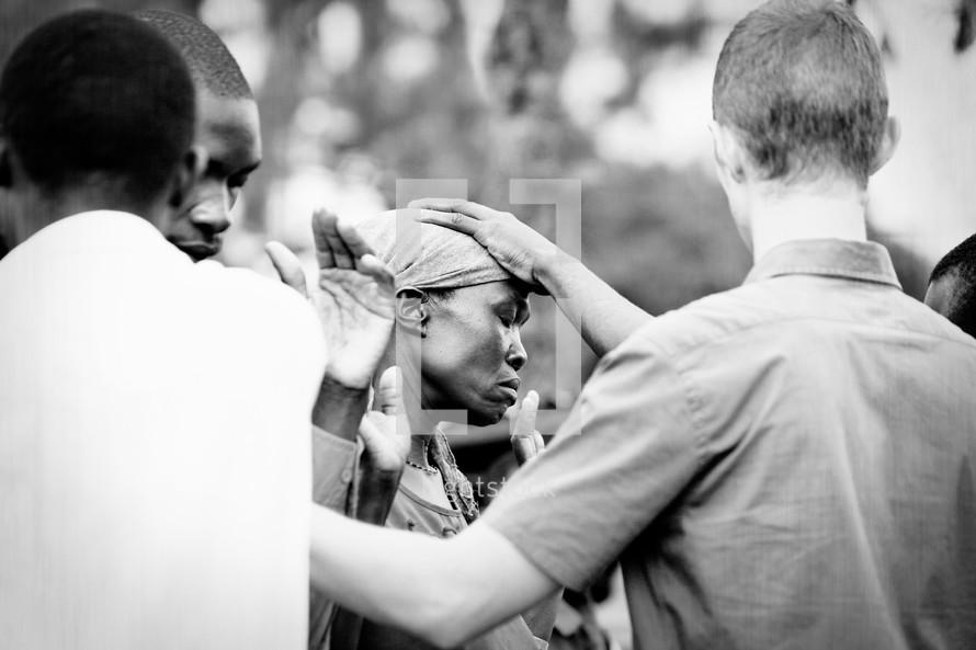 People receiving prayer