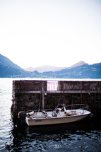 a docked boat on Lake Como
