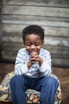 toddler boy sitting in prayer