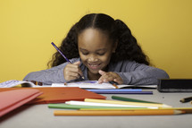 a child coloring on paper