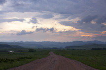 dirt road and mountains at sunset