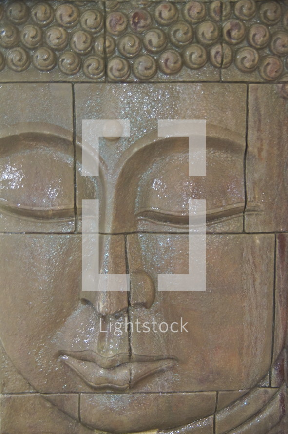 Indonesia wall carving  of Buddha