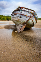 old beach boat on sand