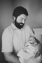 a father rocking a newborn