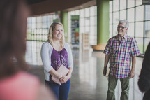 conversations in a church narthex before a worship service