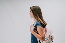 teen girl with a book bag