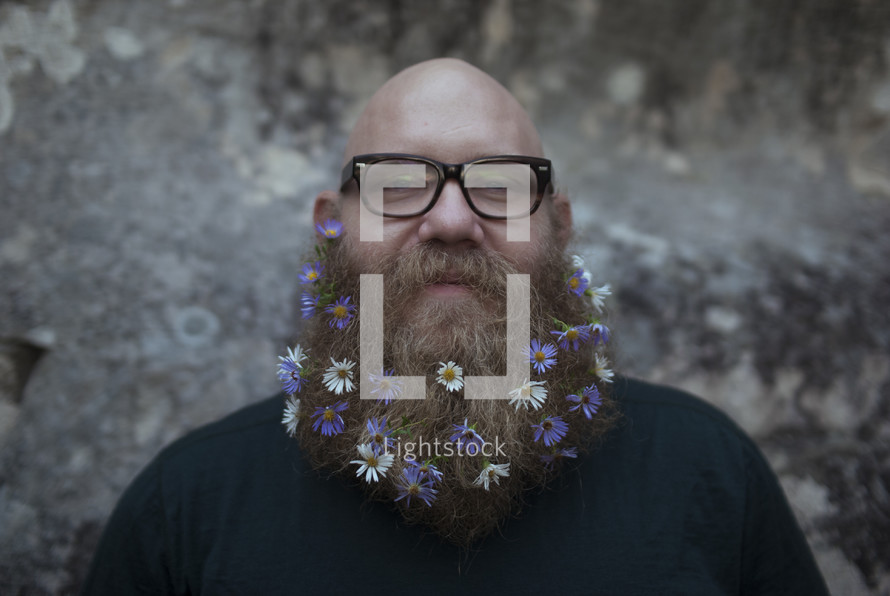 man with a thick beard with flowers