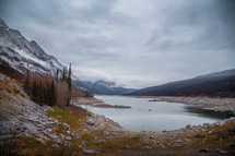 snow capped mountain peaks and lake