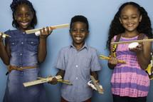 kids holding school supplies