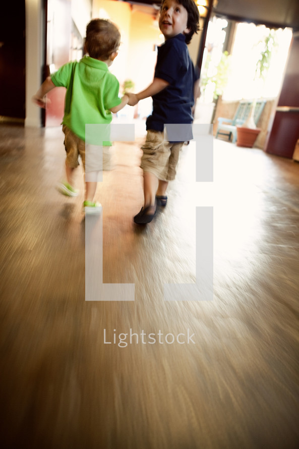 Two young boys walking together