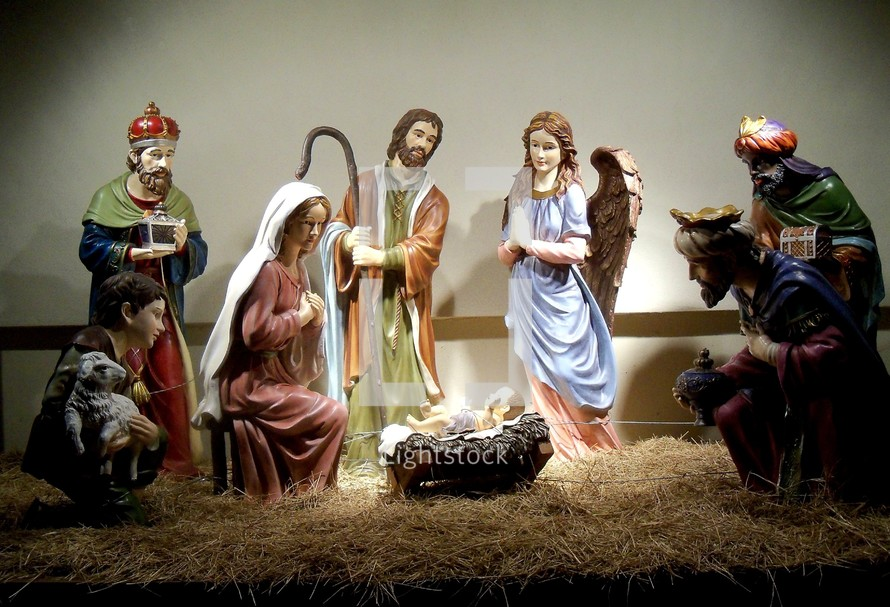 A very familiar nativity scene showing the birth of Jesus in a manager surrounded by Joseph, Mary, the three wise men and animals that come to adore the baby Jesus and celebrate his birth. A star shown in the sky to bring the wise men to see Jesus, the light of the world.