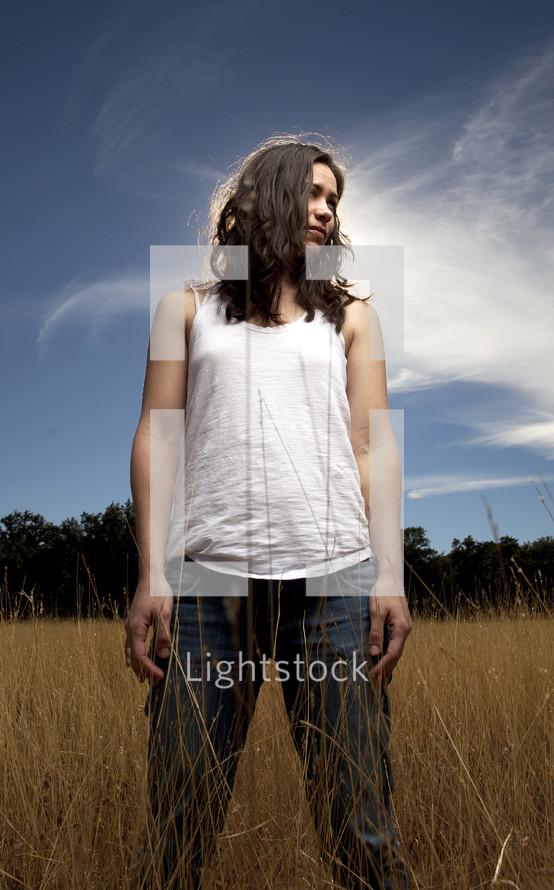Girl standing in wheat field