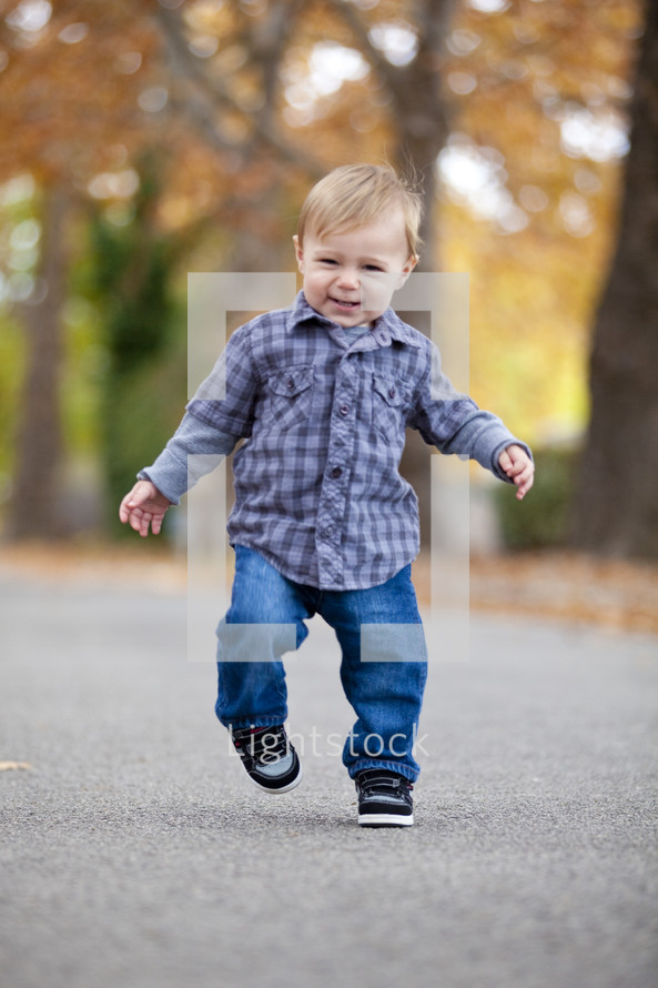 Toddler boy walking outdoors