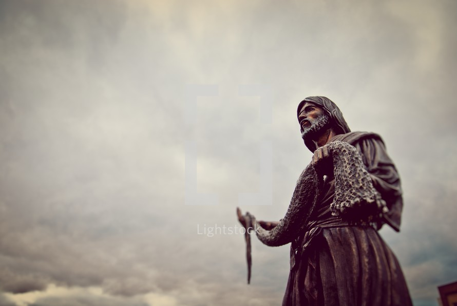 Statue of Jesus holding fishing nets