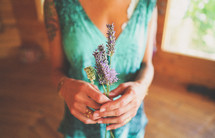 a woman holding lavender flowers