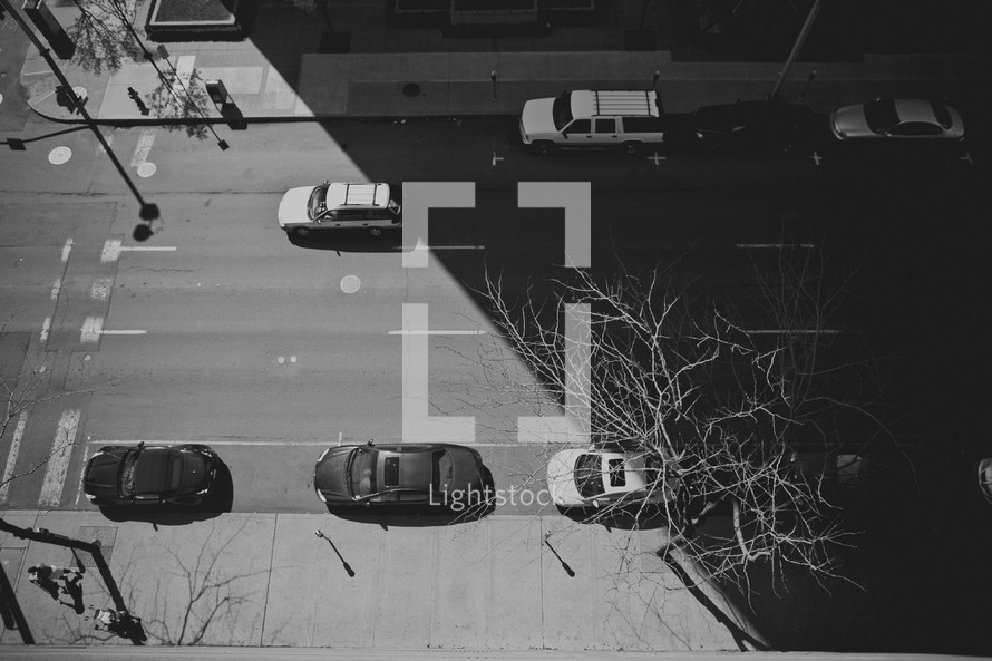 rooftop view of cars on a street