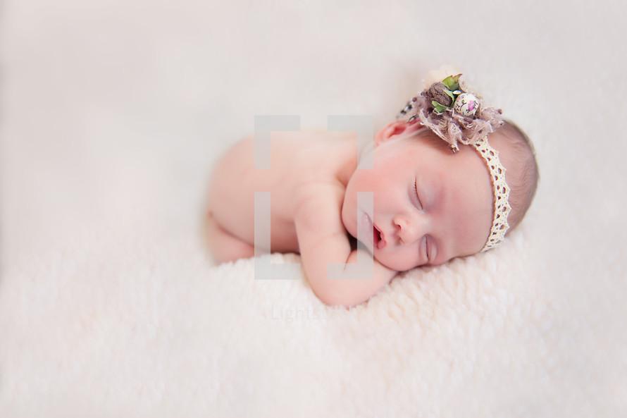 Newborn baby girl sleeping
