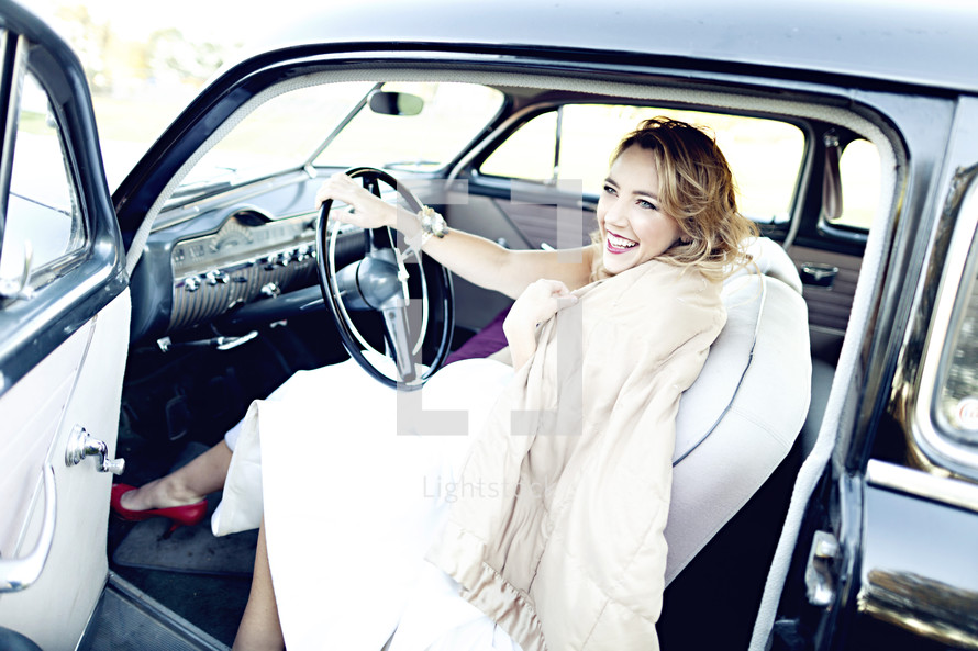 Woman driving classic car red shoes scarf  joy smile