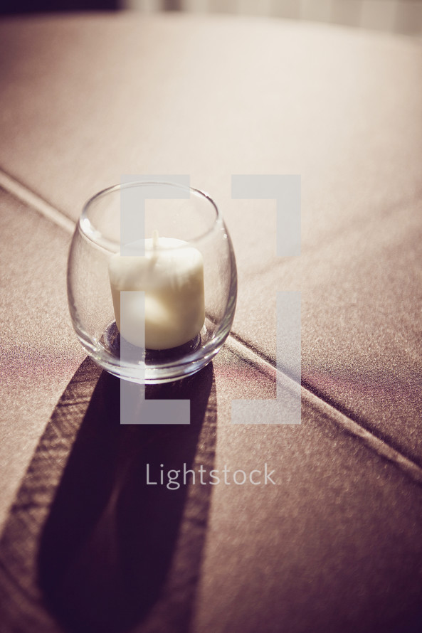 votive candle on the floor