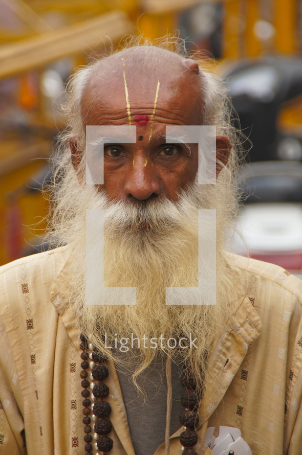 Elderly Hindu man from the Bendiwali sect, southern India, with long white beard and prayer beads around his neck.