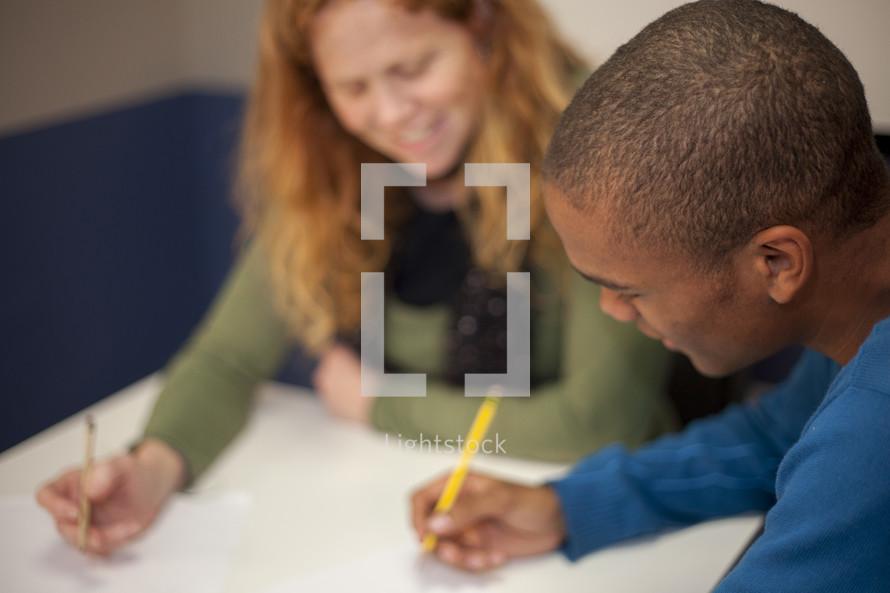 two teens writing