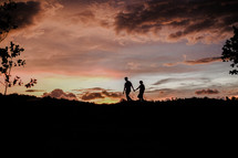 Silhouette of a couple walking during sunset
