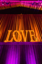 "Illuminated ""love"" sign"