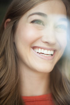 a woman's smiling face