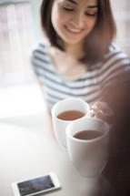 women toasting coffee cups