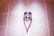 Wedding rings sitting inside of bible