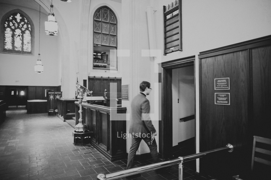 A man leaving the church sanctuary