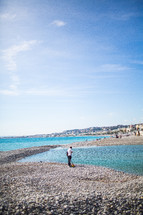 fisherman on a rocky beach