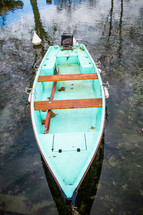 a boat floating on a pond in France