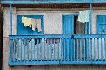 Clothes drying on a clothesline over a balcony