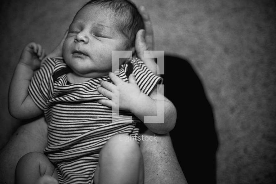 newborn in father's hands
