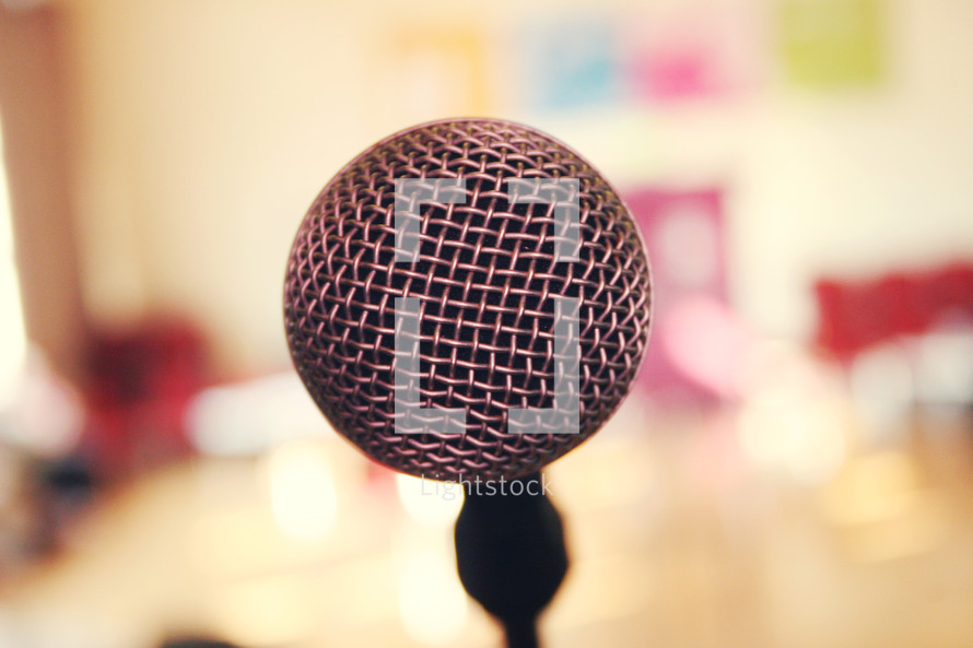 Close up of microphone. I shot this at a Christian event in Ireland, when I took it the image looked inviting to me giving a sense of 'come on, tell your story.'