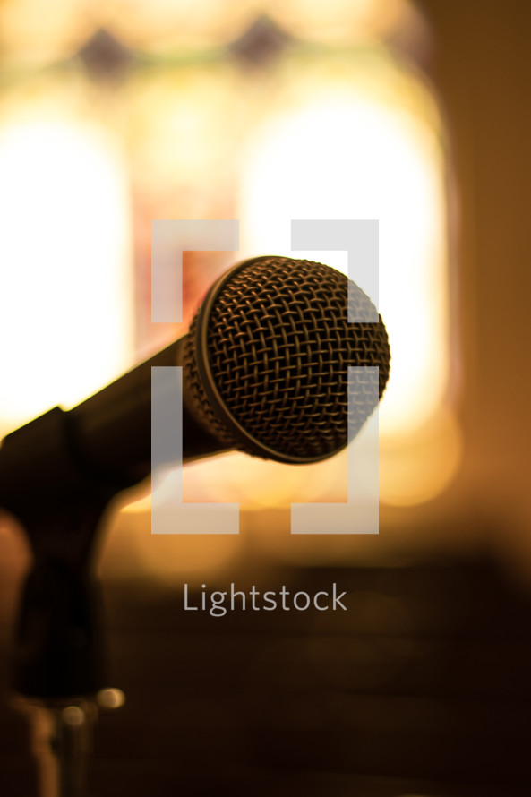 microphone and bright lights in a church