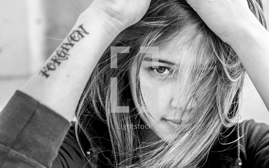 woman with a forgiven tattoo
