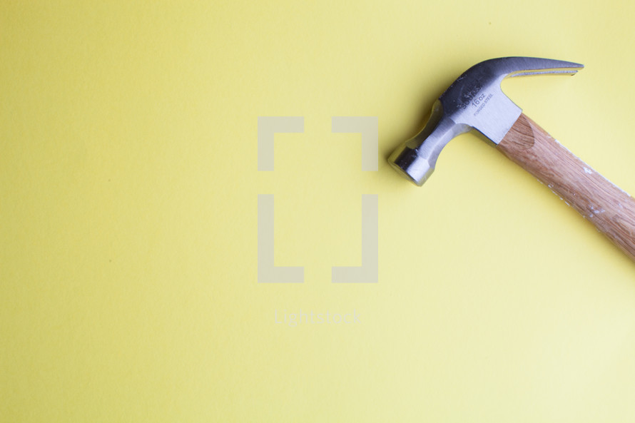 Hammer on a yellow background.