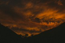 red clouds in the sky and mountains