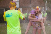 teens after a color run taking a picture