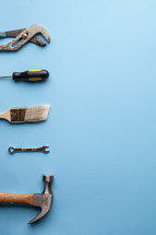 Tools lined up on the left side of a blue background.