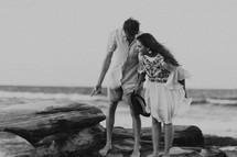 a couple exploring a rocky shore