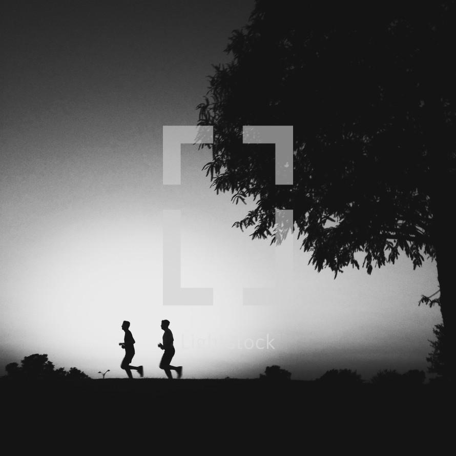 Men jogging outdoors