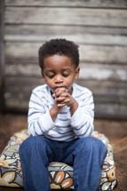 toddler boy with praying hands