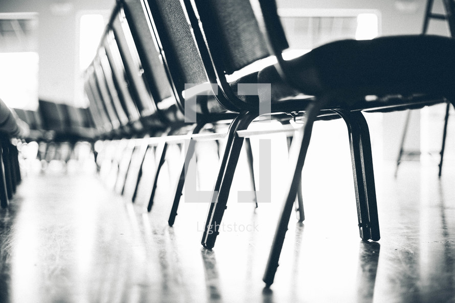 Rows of chairs in black and white