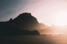 sunlight shining on a beach at sunrise