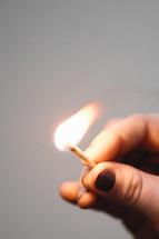 hand holding a match